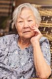 Portrait of a obaasan grandma seated, posing with the hand on. Chin. Retired, Japanese descendant Stock Photography