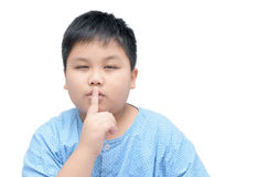 Portrait of obese fat boy with finger on lips isolated Royalty Free Stock Photography