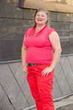 Portrait of an obese woman in red jeans with a big belly in a ci Royalty Free Stock Photos