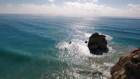 A portrait of the ocean with large rocks stock footage