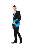 Portrait od a businessman standing with blue folder Royalty Free Stock Photo