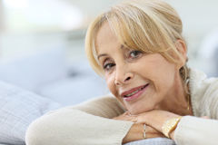 Portrait od fashionable elderly woman in sofa Royalty Free Stock Images