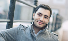 Portrait od smiling gorgeous young attractive man. Happy young man, outdoor - outside. Close up of gorgeous male in coat, coldly morning royalty free stock image