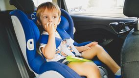 Free Portrait Of 3 Years Old Toddler Boy Sitting In Child Safety Seat In Car And Eating Cookies. Kids Travelling In Stock Image - 147909151