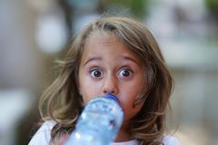 Free Portrait Of A 4 Year Old Girl Drinking Water From A Plastic Bottle Stock Photo - 165998560