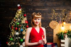 Free Portrait Of A Beautiful Happy Woman In Red Christmas Dress Holding Champagne Glass While Standing And Looking Up Over Stock Photography - 158661032