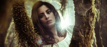 Free Portrait Of A Beautiful Lady Posing Among Trees Royalty Free Stock Photo - 107699865