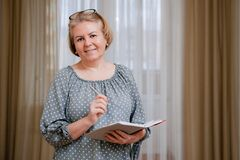 Portrait Of A Beautiful Well-groomed Pensioner 50-60 Years Old In The Room. Stock Photography