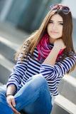 Portrait Of A Beautiful Woman Sitting On The Steps. Royalty Free Stock Photography