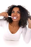 Portrait Of A Black Woman Cleaning Her Teeth Royalty Free Stock Image