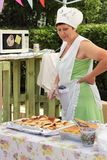 Portrait Of A Charming Waitress In Selling Pies Royalty Free Stock Photography