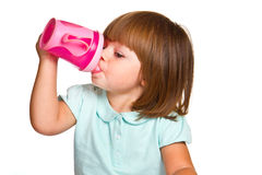 Portrait Of A Cute Drinking Little Toddler Girl Stock Images
