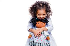 Free Portrait Of A Cute Little African American Girl Hugging Doll, Isolated On White Background Stock Photo - 193279820