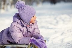 Portrait Of A Funny Little Girl On A Walk In The Winter. Child Outdoors. Stock Photos
