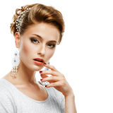 Portrait Of A Girl In A White Dress And Jewelry In A High Key. Royalty Free Stock Photo