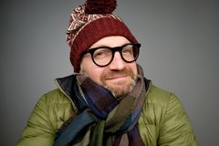 Free Portrait Of A Handsome Young Man Smiling Wearing Warm Winter Coat, Scarf, And Funny Hat Stock Photography - 126747082