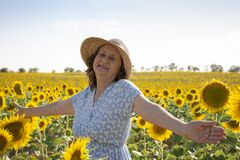 Free Portrait Of A Happy Old Woman In A Sunflower Field Stock Images - 197090884