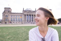Free Portrait Of A Happy Smiling Girl In Berlin, Germany. Smiling Student On The Background Of European Architecture Royalty Free Stock Photos - 140990978