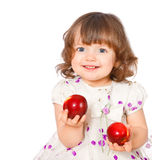 Portrait Of A Little Girl Eating Apples Royalty Free Stock Image