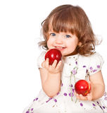 Portrait Of A Little Girl Eating Apples Stock Image