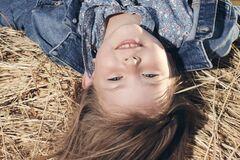 Free Portrait Of A Little Girl Upside Down On A Haystack Stock Image - 192700741