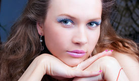 Portrait Of A Sensual Brunette With Blue Eyes Stock Photography