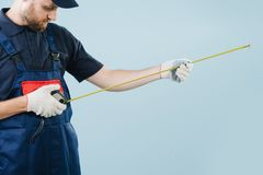 Free Portrait Of A Serious Service Worker With Tape-meter In Hands Dressed In Uniform Stock Photo - 155708670