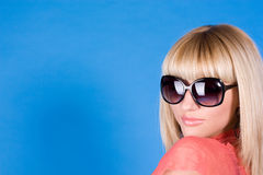 Portrait Of A Sexual Girl With Glasses On A Blue Stock Photos
