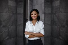 Free Portrait Of A Smiling Mixed Races Business Woman, Crossed Arm Royalty Free Stock Image - 192330596