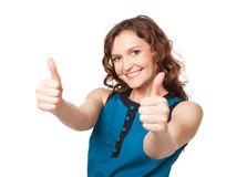Portrait Of A Smiling Woman While Giving Two Thumbs Up Royalty Free Stock Photography