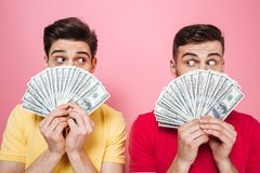 Portrait Of A Surprised Gay Male Couple Holding Money Stock Image