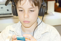 Free Portrait Of A Sweet Young Boy Listening To Music Stock Photography - 35016152
