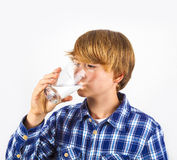 Portrait Of A Teen Boy With Blonde Hair Drinking Water Stock Photography