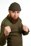 Portrait Of A Young Bearded Guy In A Hat Showing His Fists Stock Photography