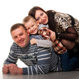 Portrait Of A Young Happy Smiling Family Stock Photos