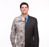 Portrait Of A Young Man With Split Careers Businessman And Soldier. Stock Images