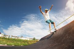 Free Portrait Of A Young Skateboarder Doing A Trick On His Skateboard On A Halfpipe Ramp In A Skate Park In The Summer On A Royalty Free Stock Photo - 171746115