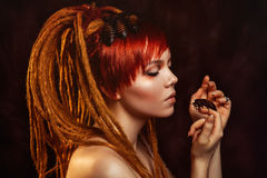 Portrait Of A Young Woman With Cockroaches Stock Photography