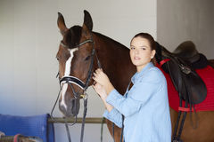 Portrait Of A Young Woman With Her Bay Horse Stock Photos