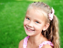Free Portrait Of Adorable Smiling Little Girl In The Park Royalty Free Stock Image - 92576396