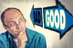 Portrait Of Adult Man Faced With Choice Between GOOD And BAD Stock Images