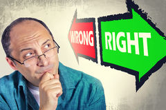 Free Portrait Of Adult Man Faced With Choice Between RIGHT And WRONG Royalty Free Stock Photography - 62317317