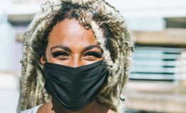 Free Portrait Of African Girl With Blond Dreadlocks Wearing Face Protective Mask For Coronavirus Prevention - Covid 19 Lifestyle And Royalty Free Stock Photos - 185024098