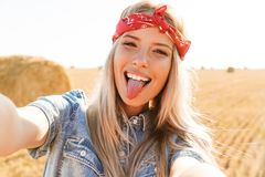 Free Portrait Of Amusing Girl 20s Laughing And Taking Selfie While Wa Stock Image - 129361331