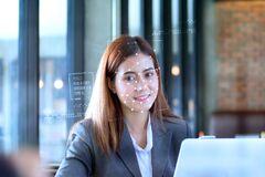 Free Portrait Of An Professional Investment Advisor Businesswoman Sitting In Front Of Laptop At Her Desk While Looking At Camera And Royalty Free Stock Photography - 182409647