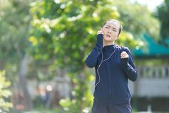 Free Portrait Of Asian Woman Wearing Earphones Listening To Music Was Sick With Irritate Itching Her Skin At Park Stock Photo - 189114280