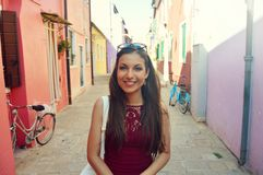 Free Portrait Of Attractive Fashion Woman Looking At Camera In Burano Typical Alley With Lights And Shadows, Venice, Italy. Stock Photos - 110512553