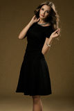 Portrait Of Beautiful Blonde Woman In Black Dress. Royalty Free Stock Photography