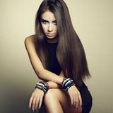 Portrait Of Beautiful Brunette Woman In Black Dress Stock Photo