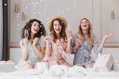 Free Portrait Of Beautiful Excited Women 20s Wearing Dresses Celebrating Bridal Shower In Posh Apartment, With Champagne And Falling C Stock Photography - 121564562